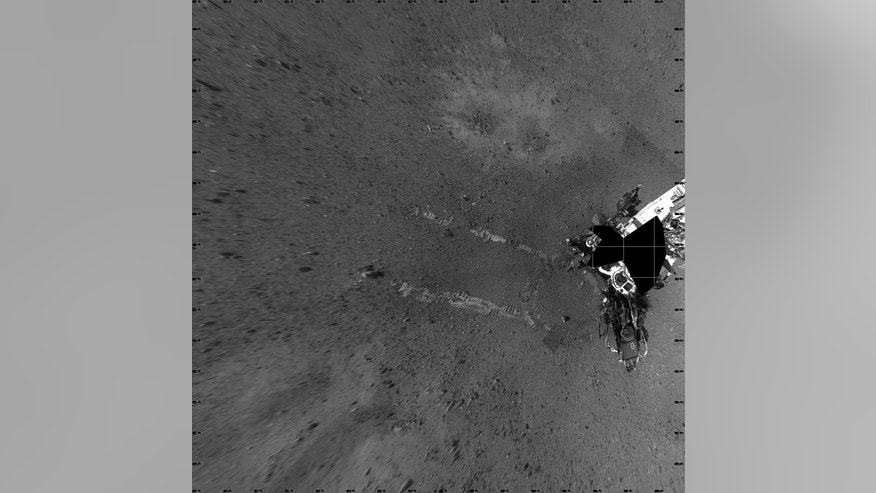 "NASA's Mars rover Curiosity took this image its landing site ""Bradbury Landing"" on Aug. 22, 2012, after a successful test drive. The landing site is named in honor of the late science fiction author Ray Bradbury, and taken on what would have be"
