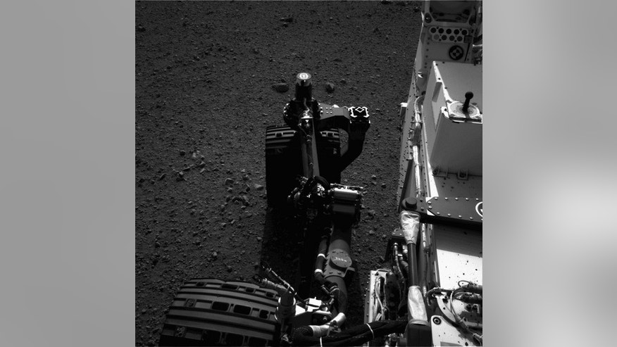 This still from a set of images shows the movement of the front left wheel of NASA's Curiosity as rover drivers turned the wheels in place at the landing site on Mars. Engineers wiggled the wheels as a test of the rover's steering and anticipat