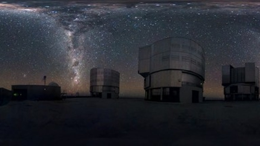 This amazing image seems to show the Milky Way streaming down not once, but twice, at ESO's Very Large Telescope on Chile's Cerro Paranal mountain. Actually, the photo shows a 360-degree panorama of the sky, so the two streams of stars are two
