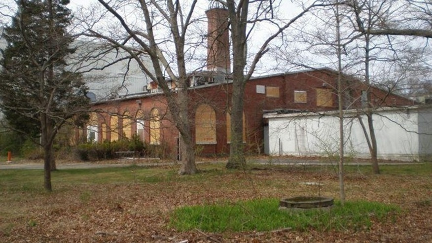 An April 2009 view of the south and east facades of Tesla's historic Wardenclyffe laboratory in Shoreham, New York. Recently, the owner boarded up the historical window frames, as a precaution against potential vandalism.
