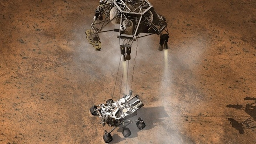 This artist's concept depicts the moment that NASA's Curiosity rover touches down onto the Martian surface.