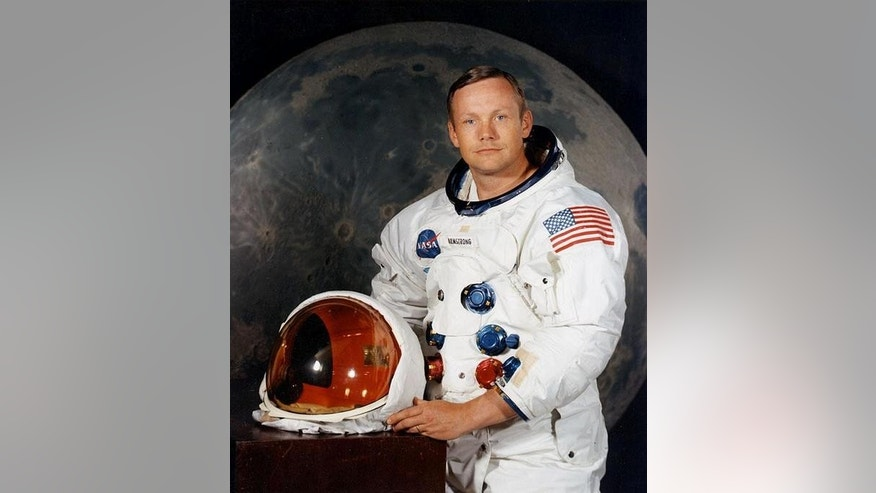 Neil Armstrong, the first man to walk on the moon, poses for his NASA portrait ahead of his historic Apollo 11 mission in July 1969.