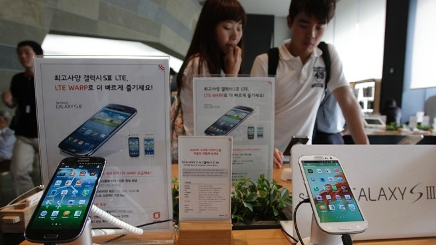 Aug. 27, 2012: Samsung Electronics' Galaxy S III phones are displayed at a mobilephone shop in Seoul, South Korea. After more than three weeks of trial in the U.S. and two days of deliberations, the nine-person jury said Friday that Samsung copied Apple's iPhone and iPad.