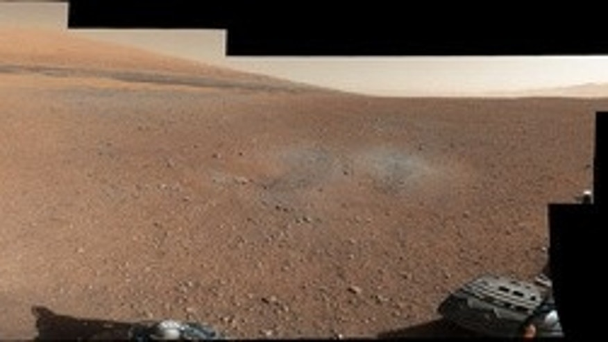 This color panorama shows a 360-degree view of the landing site of NASA's Curiosity rover, including the highest part of Mount Sharp visible to the rover. That part of Mount Sharp is approximately 12 miles (20 kilometers) away from the rover. S