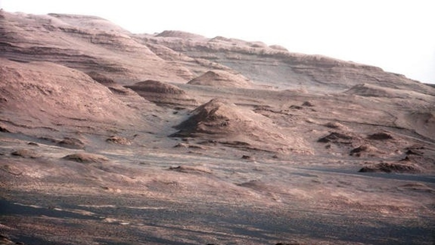 This photo from NASA's Mars rover Curiosity shows the layered geologic history of the base of Mount Sharp, the 3-mile-high mountain rising from the center of Gale Crater. Image taken on Aug. 23, 2012.