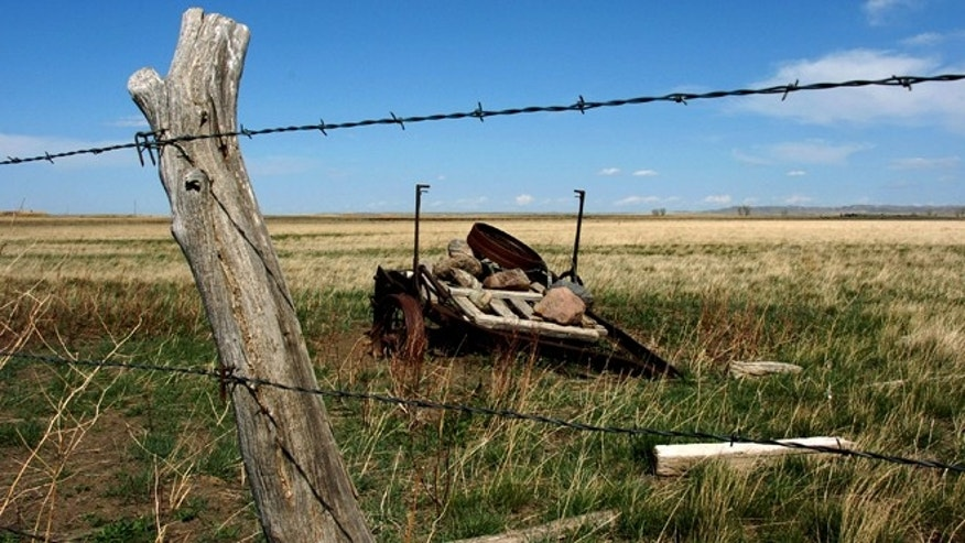 April 25, 2012: A rusted piece of farm equipment on ranchland north of the American Prairie Reserve south of Malta, Mont.