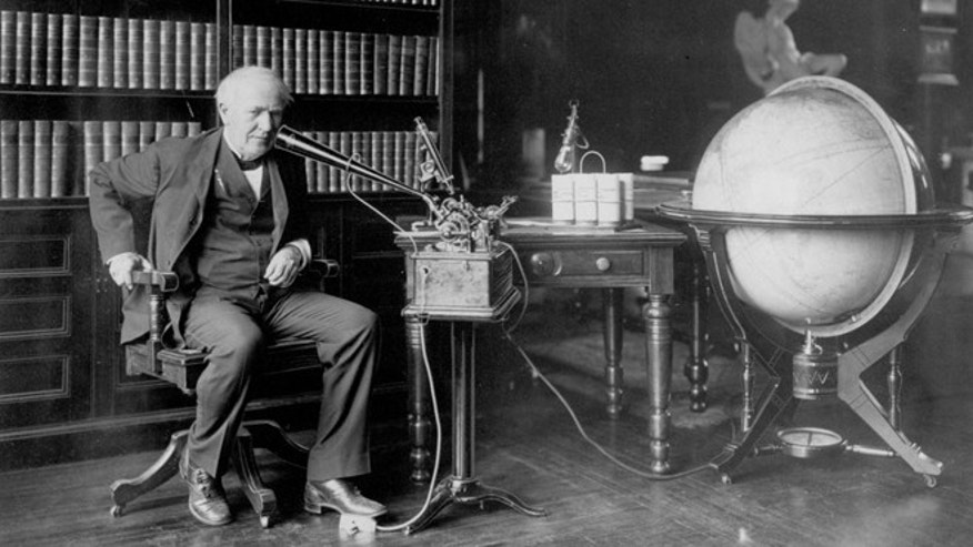 Thomas Edison dictating to an Ediphone in his library.