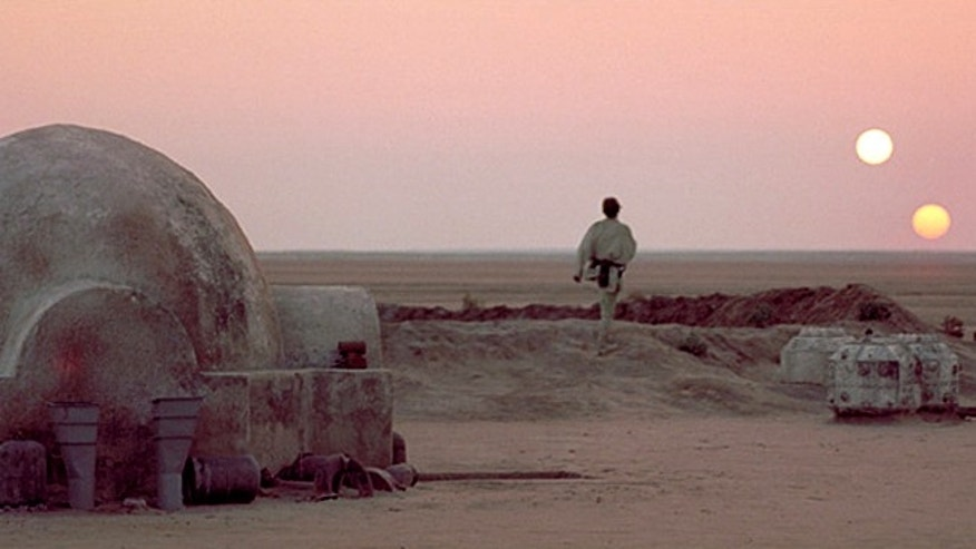 "A young Luke Skywalker stares out over the dusty planet Tatooine in this film still from the movie, ""Star Wars."""