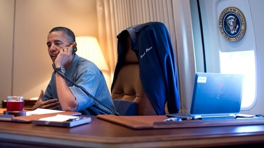 President Obama calls the NASA scientists behind the Curiosity Mars rover landing from Air Force One Aug. 13, 2012.
