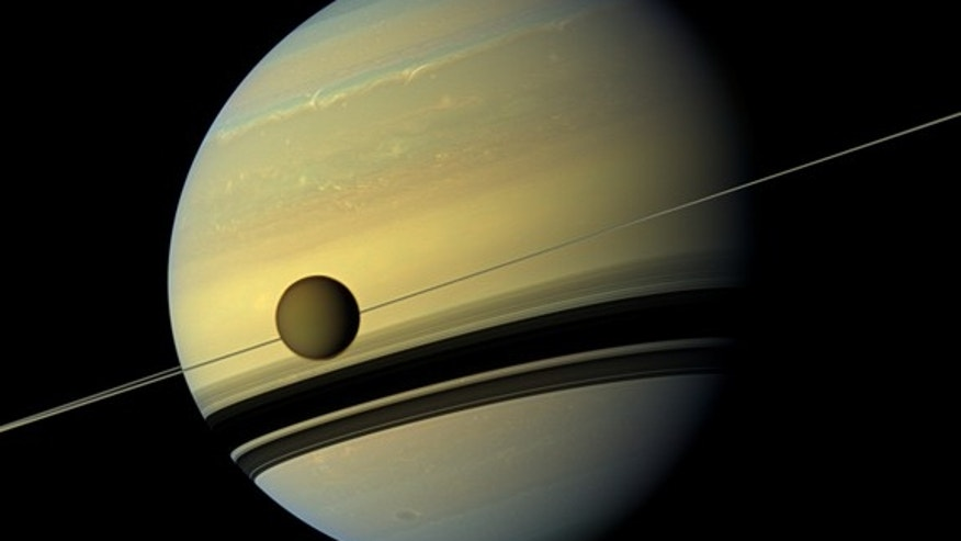 This six-image mosaic from NASA's Cassini spacecraft captures Saturn, its rings and the planet's giant moon Titan. The probe snapped the shots on May 6, 2012, when it was about 483,000 miles from Titan. Image scale is 29 miles per pixel on Tita