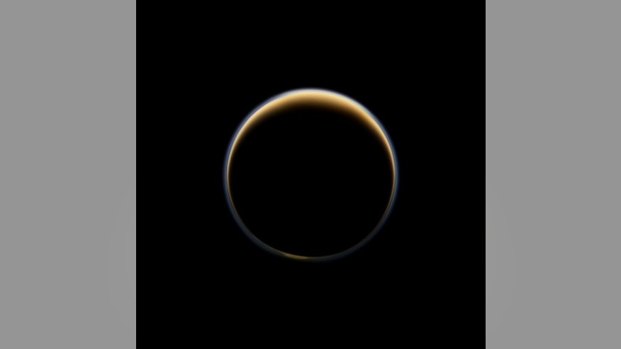 NASA's Cassini spacecraft looks toward the night side of Saturn's moon Titan and sees sunlight scattering its atmosphere, forming a colorful ring. The images were acquired on June 6, 2012, when Cassini was about 134,000 miles from Titan. Image