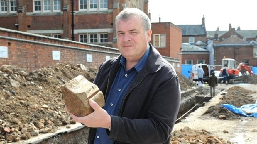Lead archaeologist Richard Buckley holds a piece of a tracery that once held a window -- just one of several medieval artifacts found at the site.