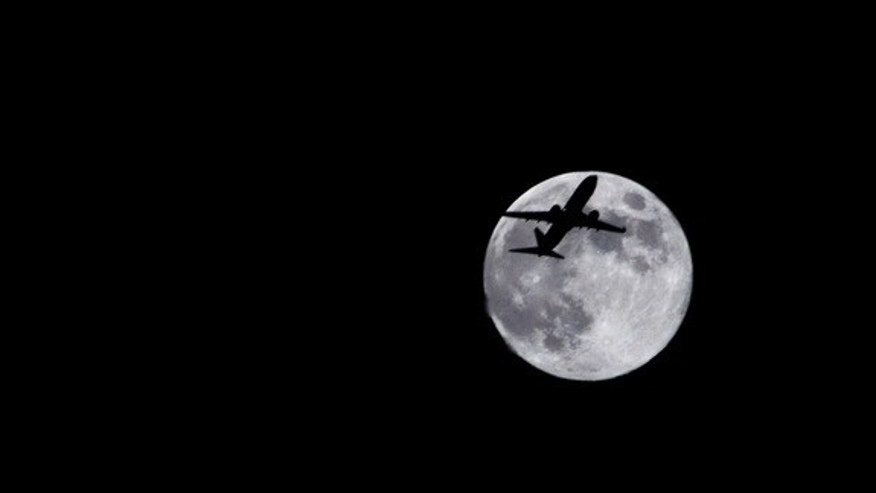 Photographer Sid Vedula captured this amazing view of the full moon of Aug. 1, 2012, from Houston, TX, with a passing airplane in silhouette.