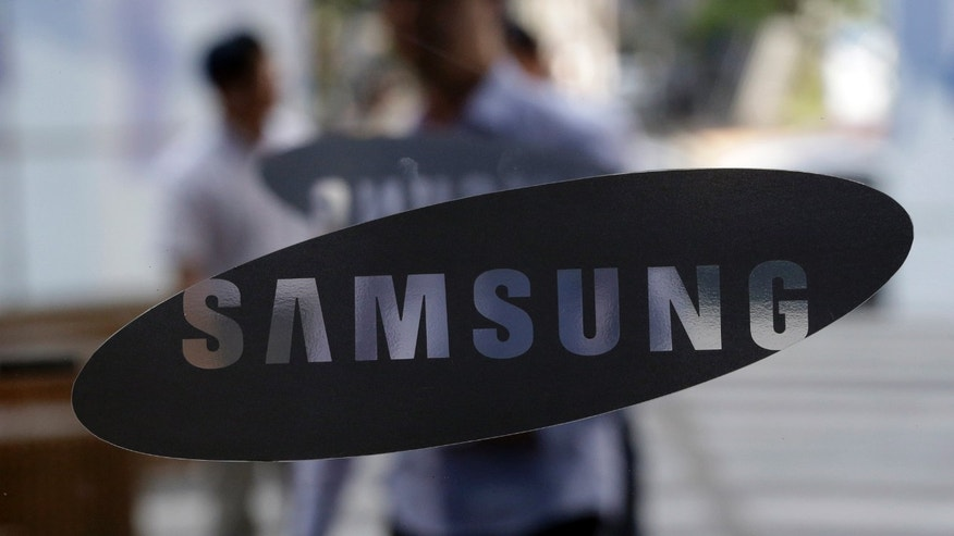 Aug. 31, 2012: People walk by the entrance to the Samsung Electronics Co. showroom at its headquarters in Seoul, South Korea.