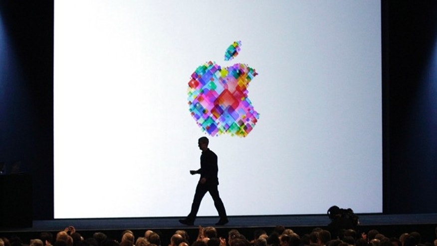 June 11, 2012: Apple CEO Tim Cook walks on stage during last year's Apple Developers Conference in San Francisco.