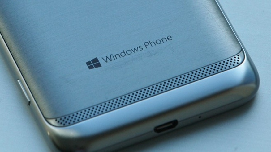 The Windows Phone 8 logo is seen on the back of a Samsung smartphone.