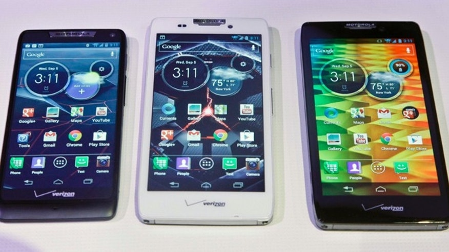 Sept. 5, 2012: Motorola's three new Droid Razr smartphones, the Droid Razr M, center, the Droid Razr HD, center, and the Droid Razr Maxx HD, are unveiled at a press conference. The phones are the first from Motorola as a part of Google.