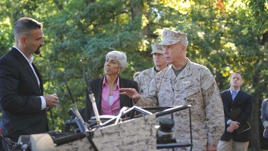 During a demonstration of two LS3 prototypes, Boston Dynamics LS3 chief engineer Kevin Blankespoor discussed capabilities with (left to right) DARPA director Dr. Arati Prabhakar, Marine Corps Warfighting Lab commanding general Brig. Gen. Mark R. Wise and Commandant of the Marine Corps, Gen. James F. Amos.