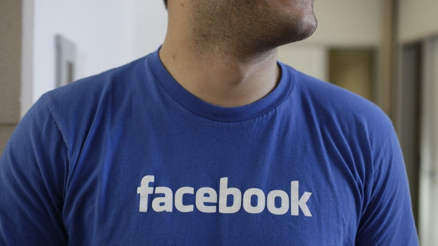 Feb. 8, 2012: A Facebook worker smiling inside Facebook headquarters in Menlo Park, Calif.