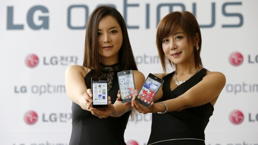 Sept. 18, 2012: Models pose with LG Electronics' new Optimus G during its unveiling ceremony in Seoul, South Korea. LG is pinning hope on the new Android device to help revive its loss-making mobile business.