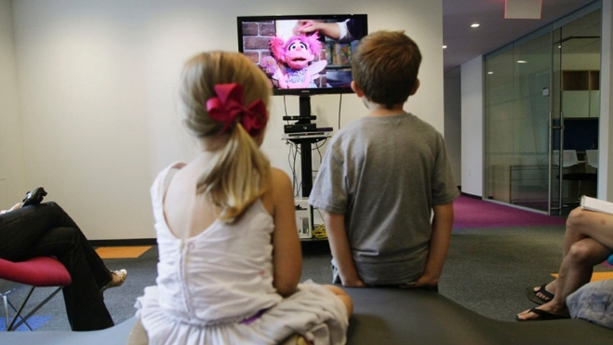 "Sept. 5, 2012: From left, Zoe Shyba, 3, and Aidan Lain, 7, play ""Kinect Sesame Street TV"" at the Sesame Street Workshop  in New York."
