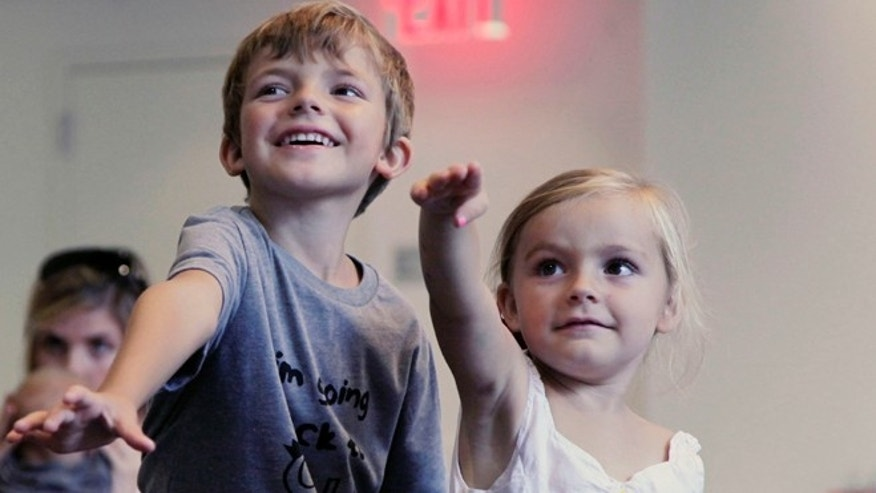 Sept. 5, 2012: From left, Aidan Lain, 7, and Zoe Shyba, 3, play &quot&#x3b;Kinect Sesame Street TV&quot&#x3b; at the Sesame Street Workshop  in New York.