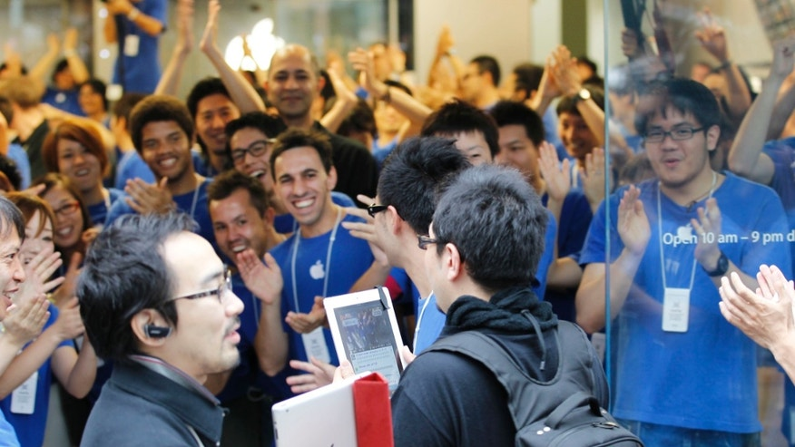 Sept. 20, 2012: Customers and staff of Apple Inc. celebrate as its store started the sale of Apple's iPhone 5 in Tokyo.