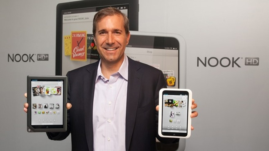 Sept. 25, 2012: William Lynch, chief executive of Barnes & Noble holds the newly announced NOOK HD+, left, and NOOK HD in New York.