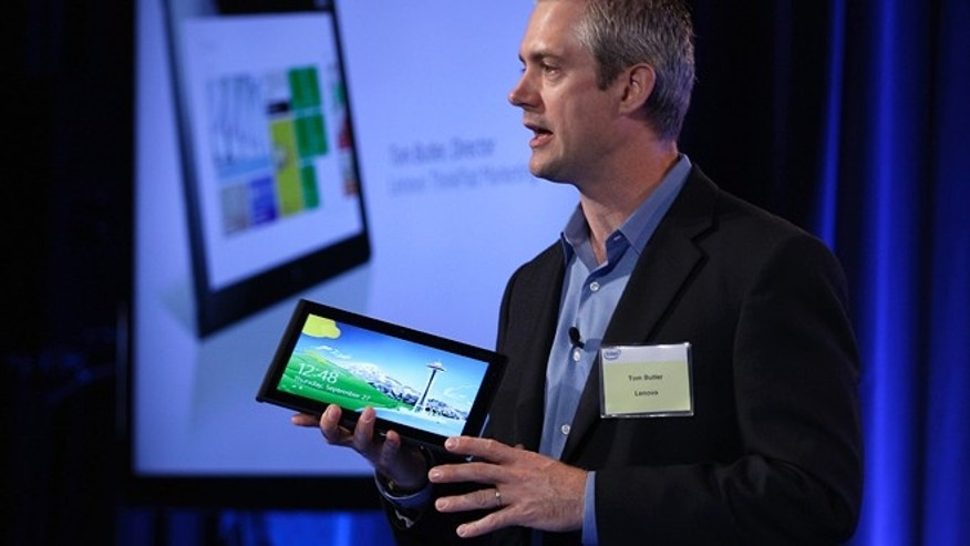 Sept. 27, 2012: Tom Butler, Director of Lenovo ThinkPad Marketing, speaks while holding a Lenovo tablet Thursday in San Francisco. Intel previewed a wave of tablet computers powered by a microprocessor that the company redesigned to make a bigger dent in the rapidly growing mobile market.