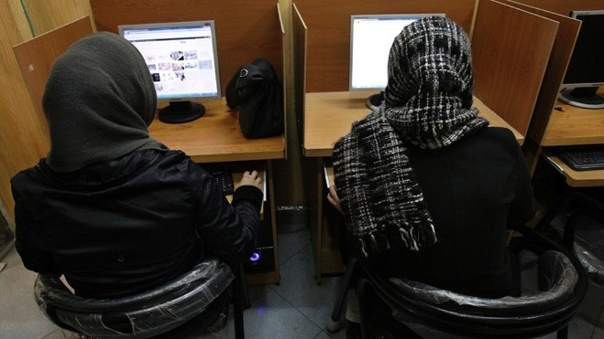 Feb. 13, 2012: Iranian women use computers at an Internet cafe in central Tehran.