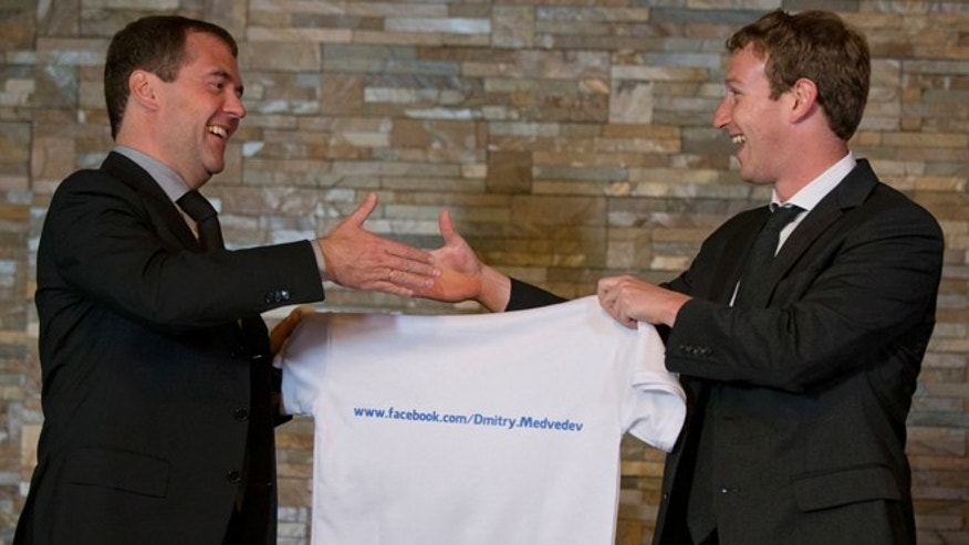 Oct. 1, 2012: Russian Prime Minister Dmitry Medvedev, left, shakes hands with Facebook CEO Mark Zuckerberg at the Gorki residence outside Moscow. Zuckerberg presented Medvedev with a T-shirt bearing his Facebook address.
