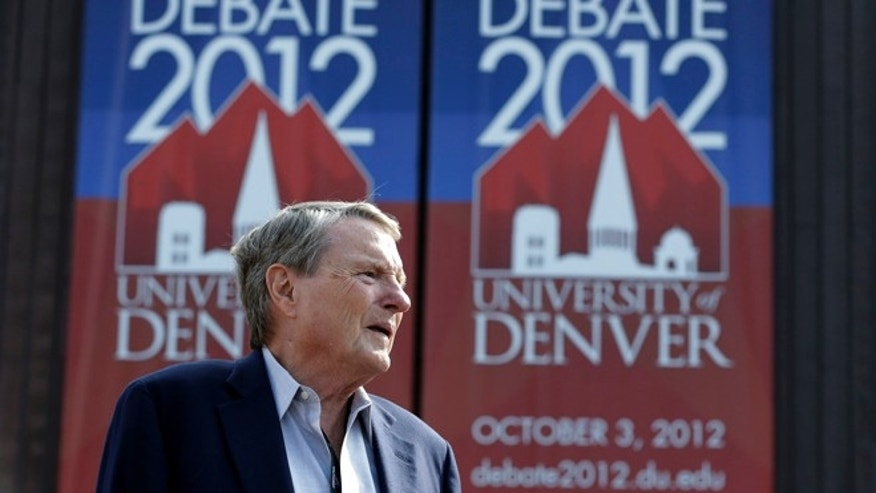 Oct. 1, 2012: Debate moderator Jim Lehrer stands outside the Magness Arena at the Daniel L. Ritchie Center for Sports and Wellness, site of Wednesday's presidential debate, on the campus of the University of Denver.