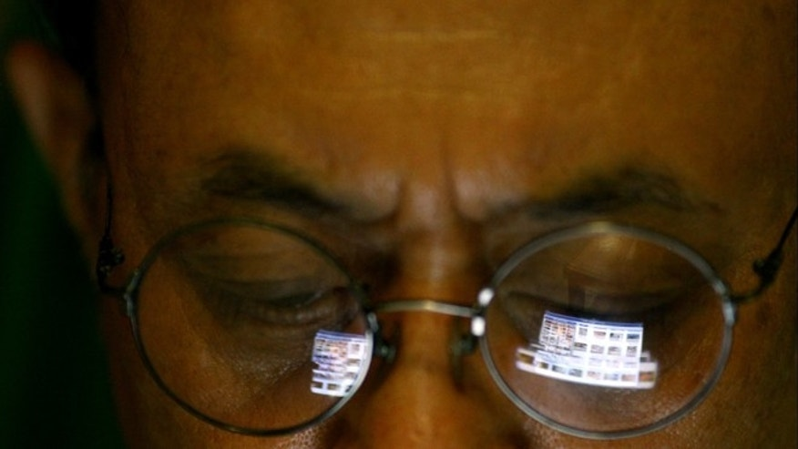 Sept. 27, 2012: A Vietnamese man logs onto the Internet on his iPad in Hanoi, Vietnam.