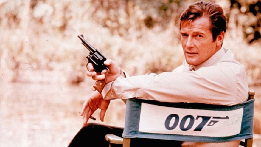 British actor Roger Moore, playing the title role of secret service agent 007, James Bond, on location in England in 1972.  Moore, played Bond in seven films, more than any other actor.