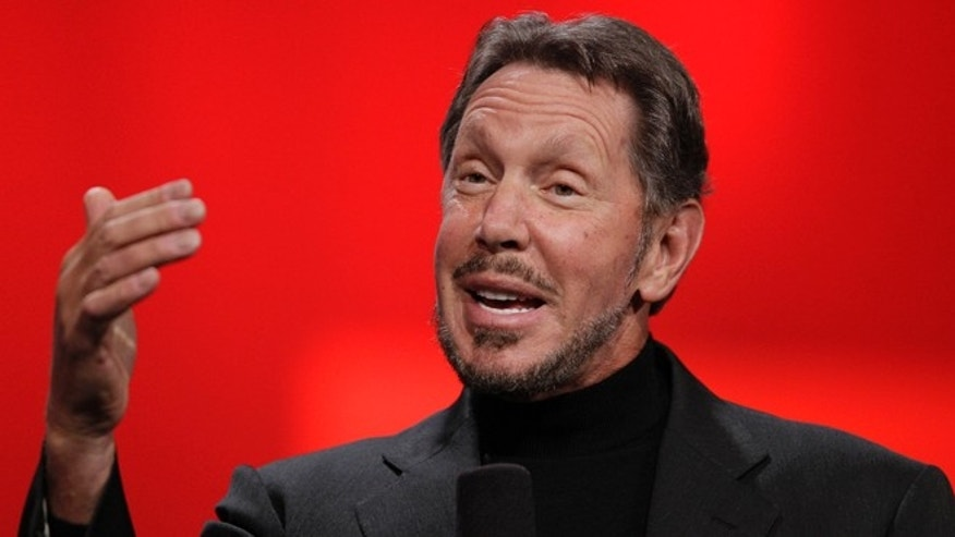 Oct. 2, 2012: Oracle CEO Larry Ellison gestures while giving a keynote address at Oracle OpenWorld in San Francisco. Ellison says he hopes to convert sea water into fresh water on the 141-mile-square mile island of Lanai.