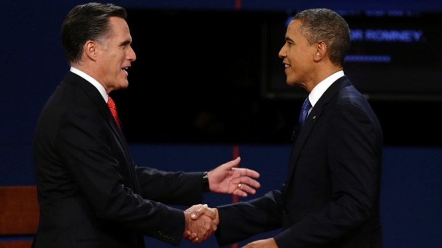 Oct. 3, 2012: Republican presidential nominee Mitt Romney  and President Barack Obama  shake hands before the first presidential debate at the University of Denver.