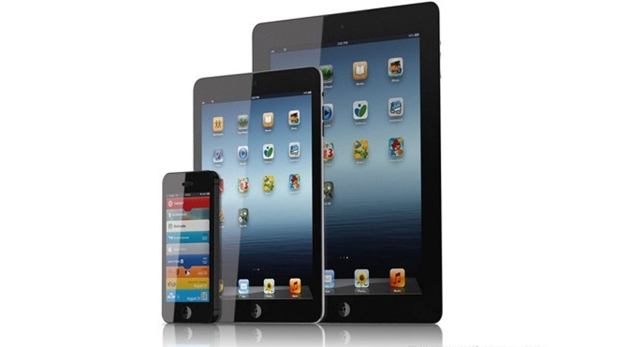 "An artist's conception of what an iPad mini might look like, alongside the ""big brother"" fullsize iPad and the smaller iPhone."