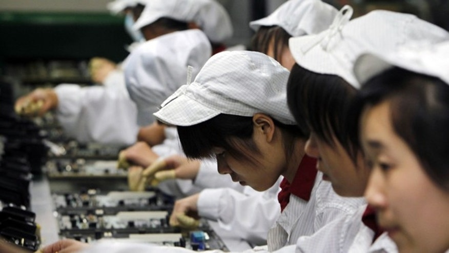 May 26, 2010: Workers on the production line at the Foxconn complex in Shenzhen, China.