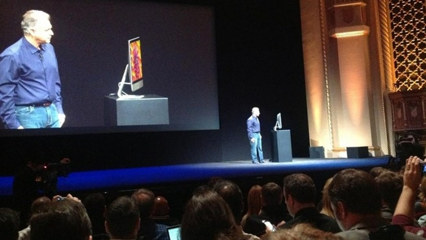 Oct. 23, 2012: Apple vice president of marketing Phil Schiller shows off the company's new iMac, a razor-thin product that drew oohs and aahs from the assembled crowd.