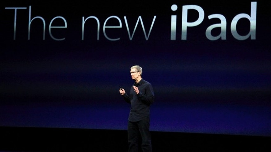 March 7, 2012: Apple CEO Tim Cook announces a new full-size iPad during an Apple announcement in San Francisco. Apple fans believe they have figured out the particulars of a smaller iPad expected to be revealed on Tuesday, Oct. 23 -- everything but the price, that is.