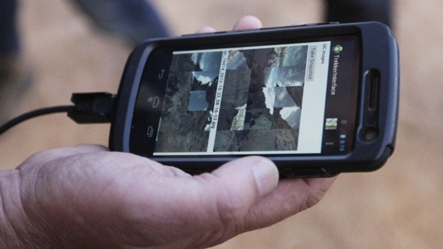 Oct. 22, 2012: Google operations manager Steve Silverman shows low-resolution images of photos gathered by the Trekker on an Android phone during a demonstration for the media along the Bright Angel Trail at the South Rim of the Grand Canyon National Park in Arizona.