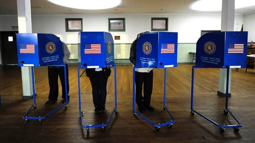 FILE: Nov. 6, 2012: Early morning voting in Point Lookout , N.Y..