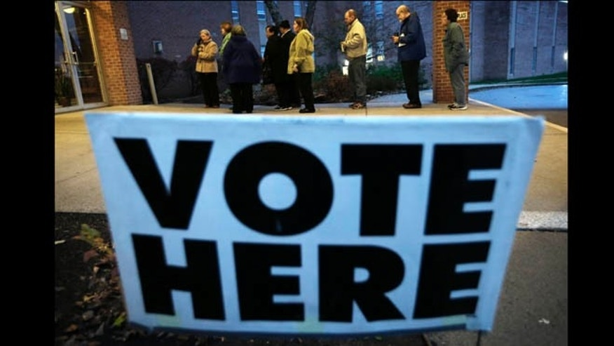 Nov. 6, 2012: Voters wait in line for the doors to Precinct 39 to open before casting their ballots on Election Day at the First Church of the Open Bible in Des Moines, Iowa.