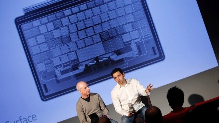 Oct. 16, 2012: Steve Sinofsky, president of Microsoft's Windows division, and Panos Panay, general manager of Microsofts Surface team, discuss the Surface tablet in the company's Redmond, Wash., headquarters.
