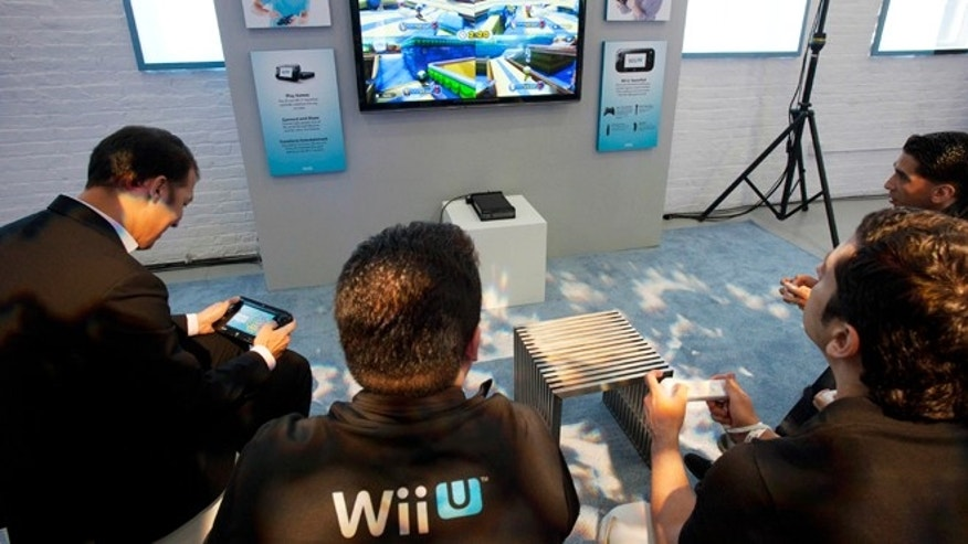 Sept. 13, 2012: People demonstrate the Nintendo's Wii U GamePad and console in New York. Nintendo seeks to shake up gaming again with the Wii U touchscreen controller.