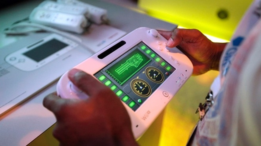 June 5, 2012: An attendee plays a video game using Nintendo's Wii U controller at E3 2012 in Los Angeles.