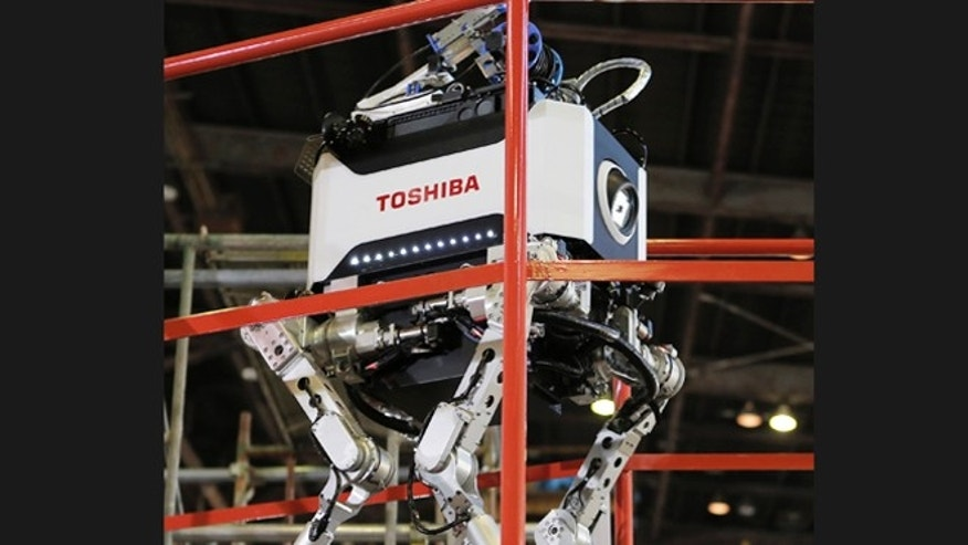Nov. 21, 2012: Toshiba's nuclear inspection robot walks on a stage during a demonstration at a Toshiba factory in Yokohama, west of Tokyo.