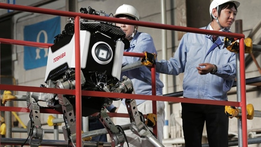 Nov. 21, 2012: Toshiba's nuclear inspection robot breaks down as its staff look on during a demonstration at a Toshiba factory. It had to be lifted by several people and rebooted.