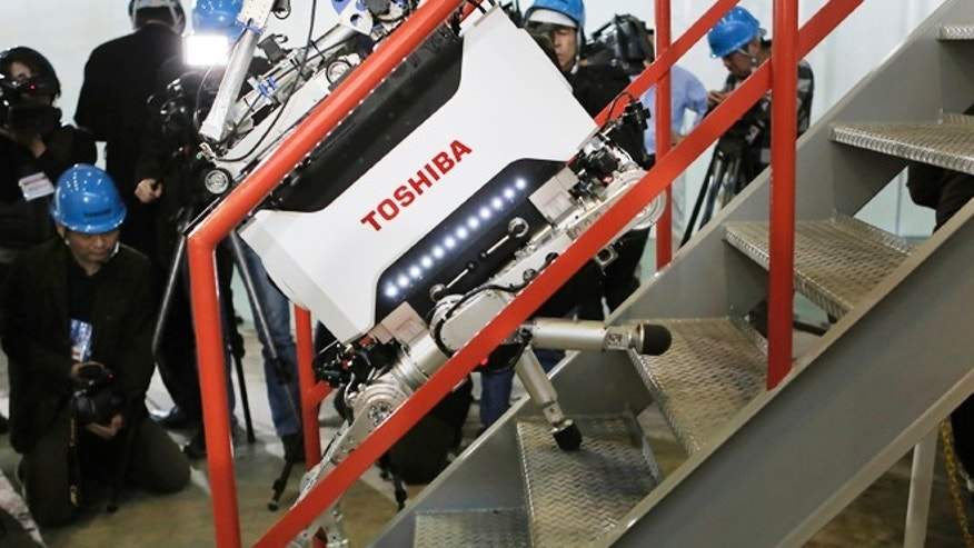 Nov. 21, 2012: Toshiba's nuclear Inspection robot climbs stairs during a demonstration at a Toshiba factory in Yokohama, west of Tokyo.
