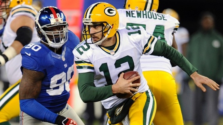 Nov. 25, 2012: Green Bay Packers&#39&#x3b; Aaron Rodgers (12) scrambles away from New York Giants defensive end Jason Pierre-Paul (90) during the second half of an NFL football game.